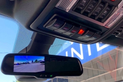 Front cam displays image in Rydeen aftermarket mirror, note custom integrated switch panel