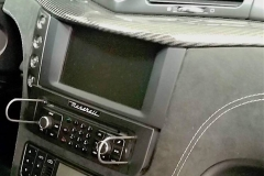 Maserati factory radio with back-up cam screen above